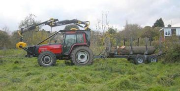 tractor towing tree trunk